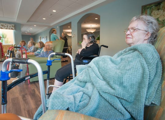 Violet Keen and fellow residents of the Seagrass Village of Panama City Beach take temporary shelter Tuesday at The Arbors of Gulf Breeze senior living community. Residents and staff from two Panama City facilities were evacuated to Gulf Breeze as Hurricane Michael approached the Panhandle.