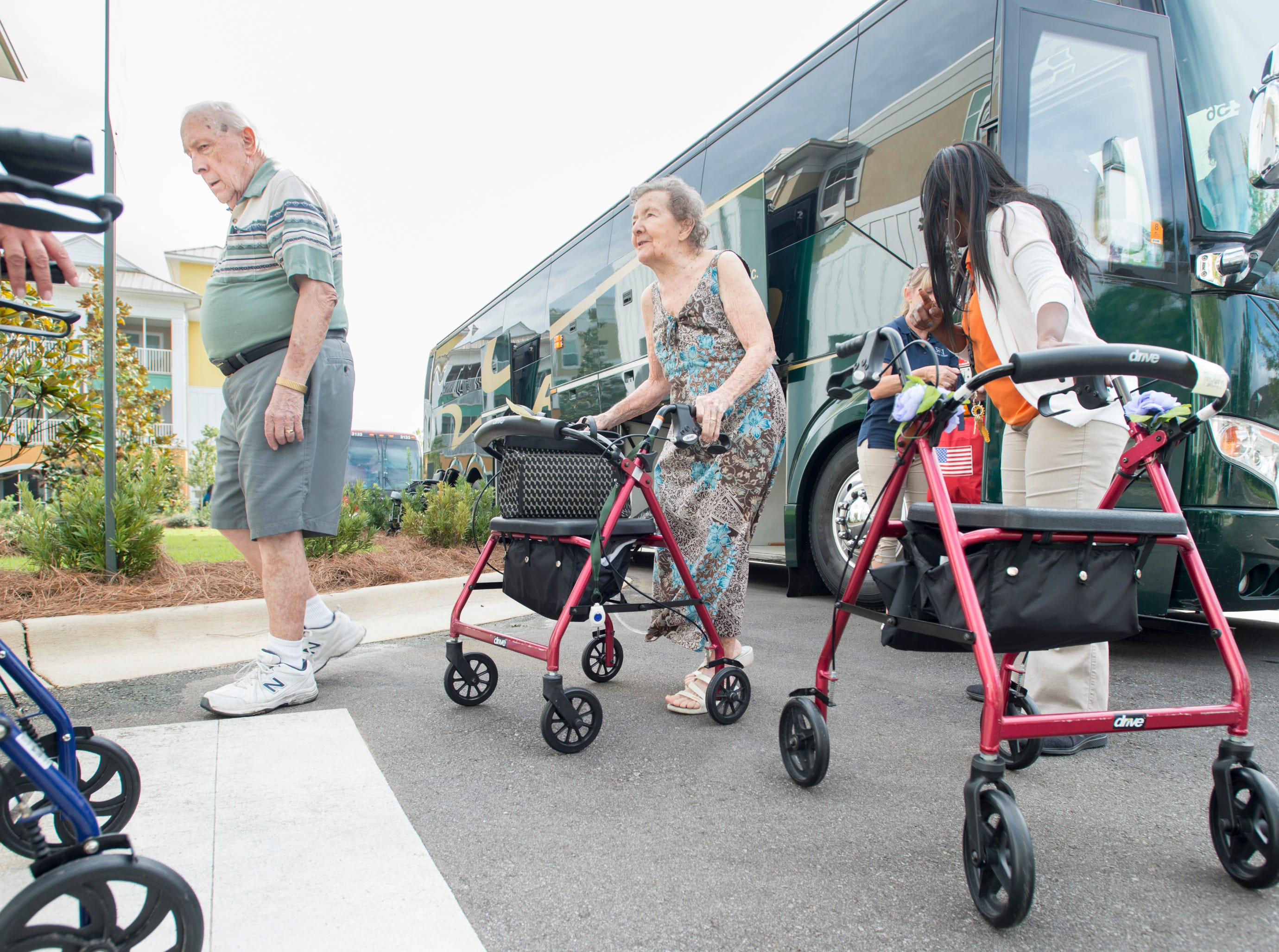 Superior Residences of Panama City Beach residents John and Alice Costello make their way from a bus to the Arbors of Gulf Breeze senior living community in Gulf Breeze on Tuesday, October 9, 2018.  Residents and staff from Panama City Beach were evacuated to this sister community as Hurricane Michael approaches the Florida panhandle.