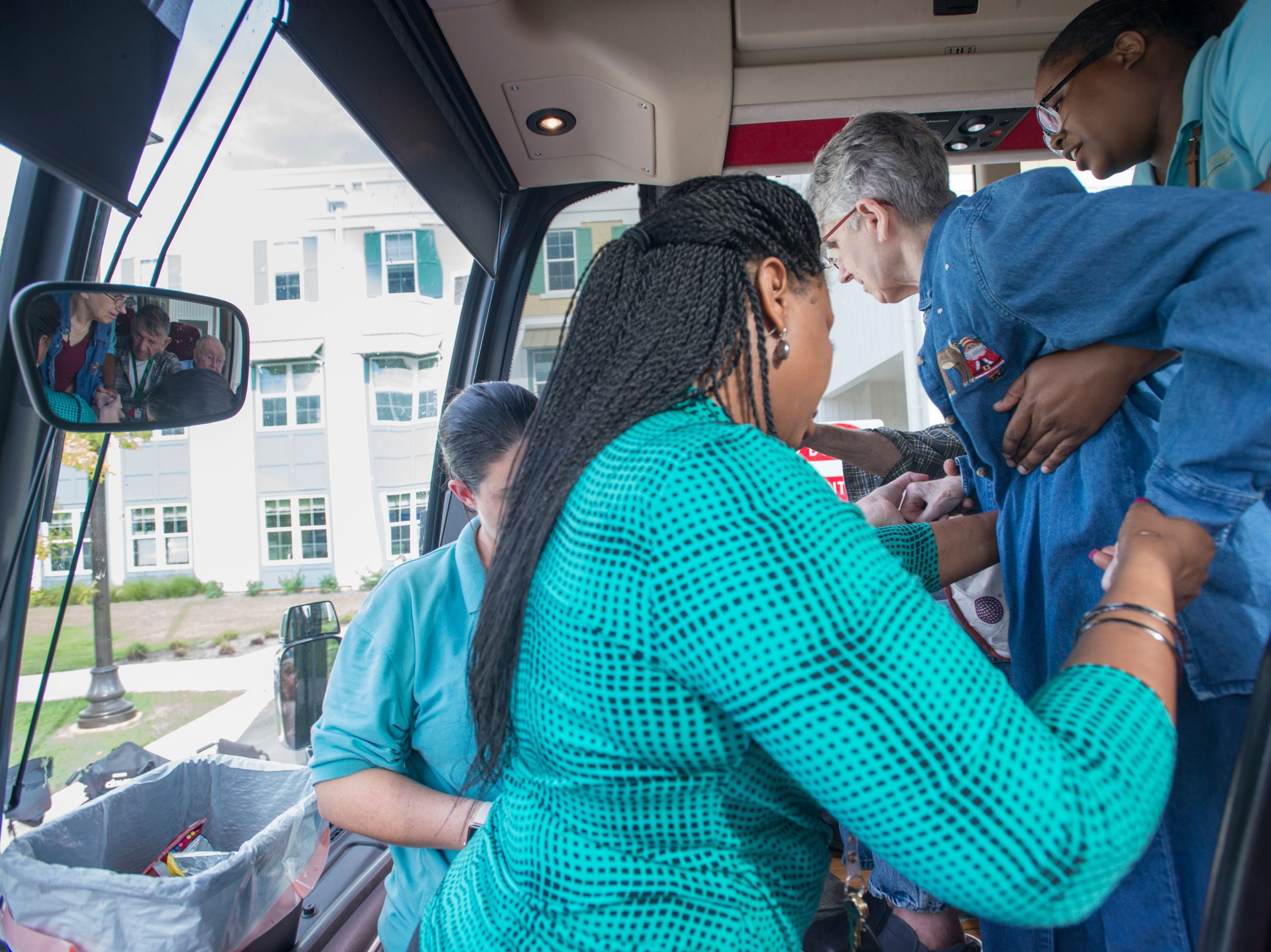 Superior Residences of Panama City Beach resident Vicki Boatwright, center, is helped off a bus at the Arbors of Gulf Breeze senior living community in Gulf Breeze on Tuesday, October 9, 2018.  Residents and staff from Panama City Beach were evacuated to this sister community as Hurricane Michael approaches the Florida panhandle.