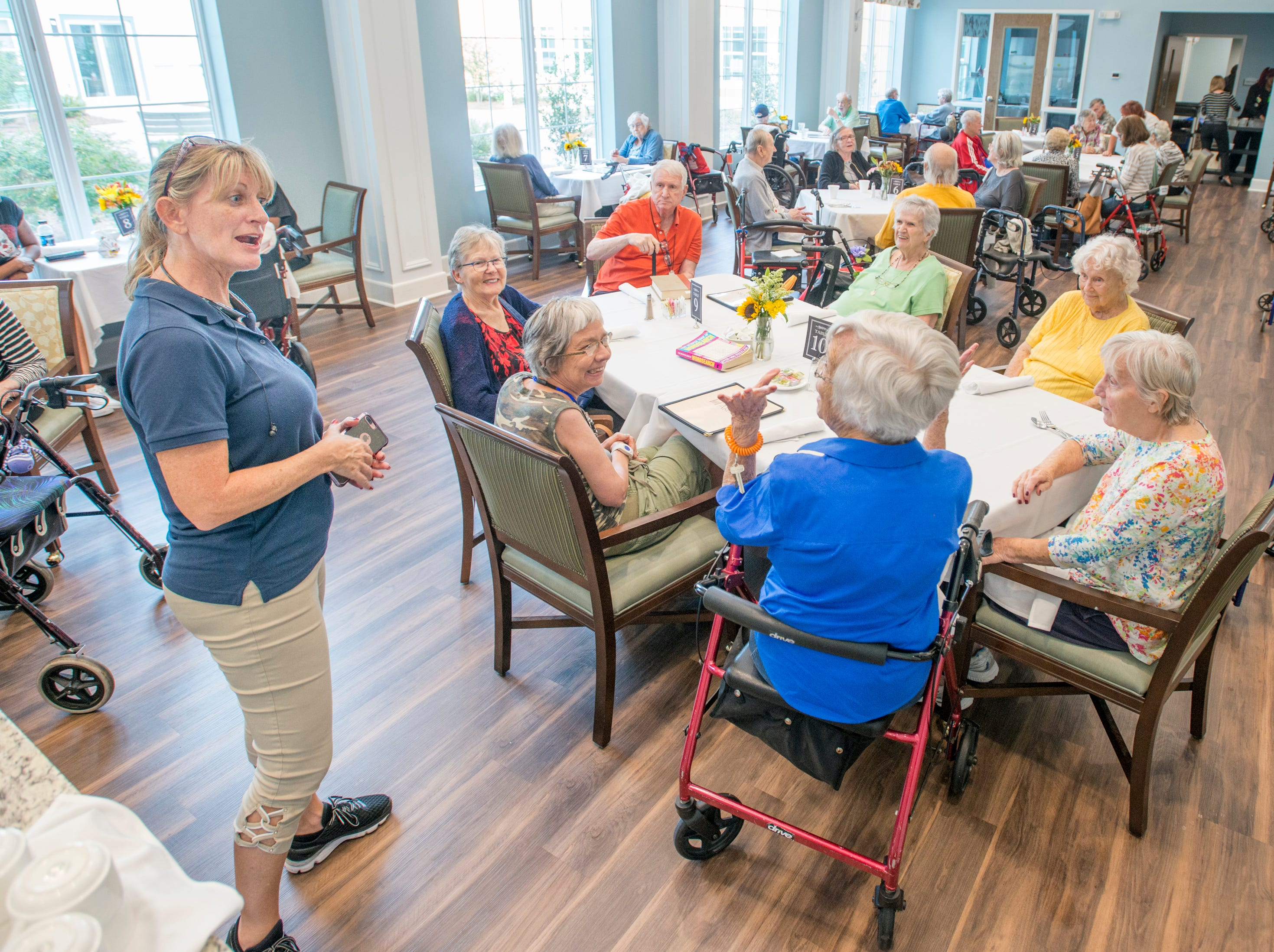 Shelley Kaiser, SRI Management senior vice president of operations, left, chats with Superior Residences of Panama City Beach residents at the Arbors of Gulf Breeze senior living community in Gulf Breeze on Tuesday, October 9, 2018.  Residents and staff from Panama City Beach were evacuated to this sister community as Hurricane Michael approaches the Florida panhandle.