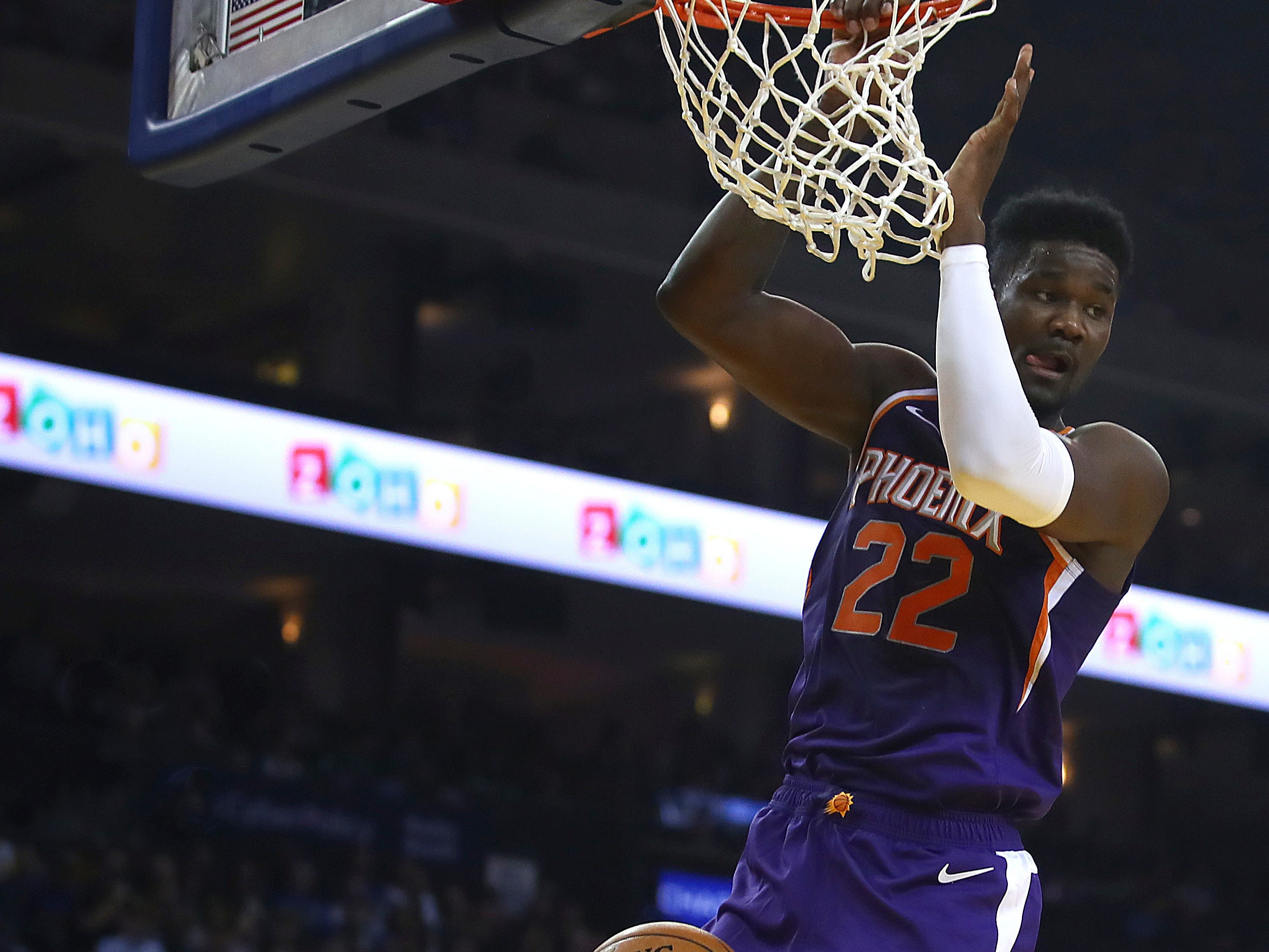 Phoenix Suns' Deandre Ayton (22) scores against the Golden State Warriors during the first half of a preseason NBA basketball game Monday, Oct. 8, 2018, in Oakland, Calif.