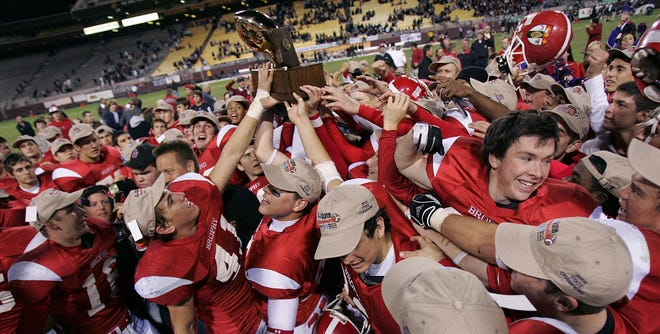 Phoenix Brophy Prep celebrates with the state championship trophy following a last-minute win over Hamilton Class 5A Division I title game, at Sun Devil Stadium in Tempe.