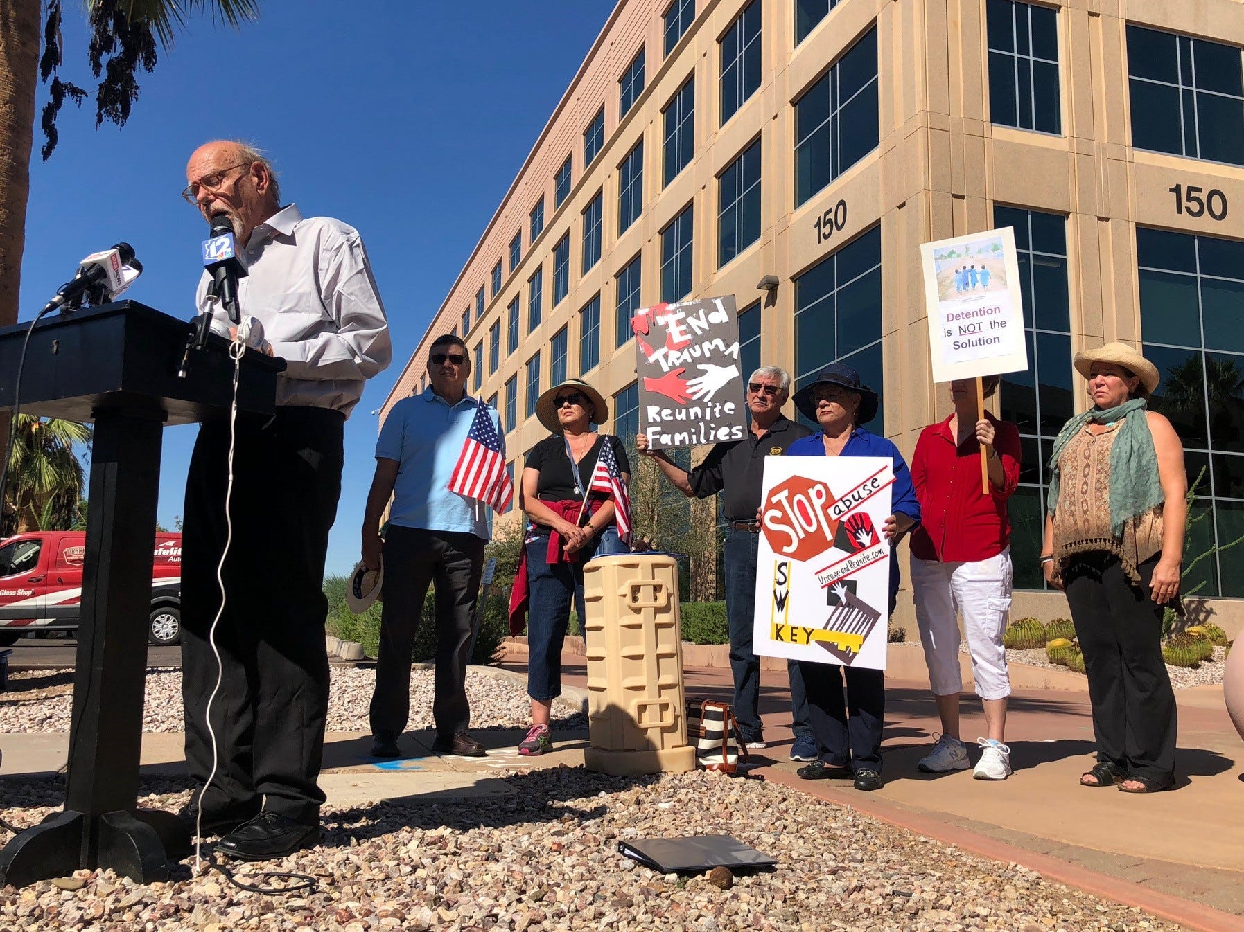 Myron Scott speaks Tuesday morning in front of the Arizona Department of Health Services building.