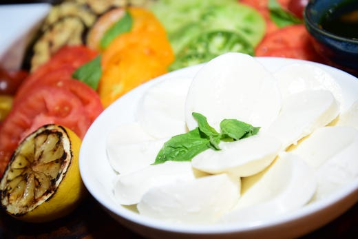 The Mozzarella And Heirloom Tomato Board Is One Of New Items Being Offered During