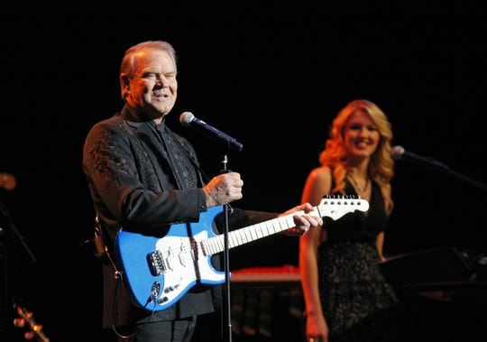 """Glen Campbell shared the stage with daughter Ashley during his """"Goodbye Tour,"""" which visited Phoenix in February 2012.  The author of 1960s hits including """"Gentle on My Mind,"""" """"By the Time I Get to Phoenix"""" and """"Wichita Lineman"""" moved to Phoenix in the 1980s."""