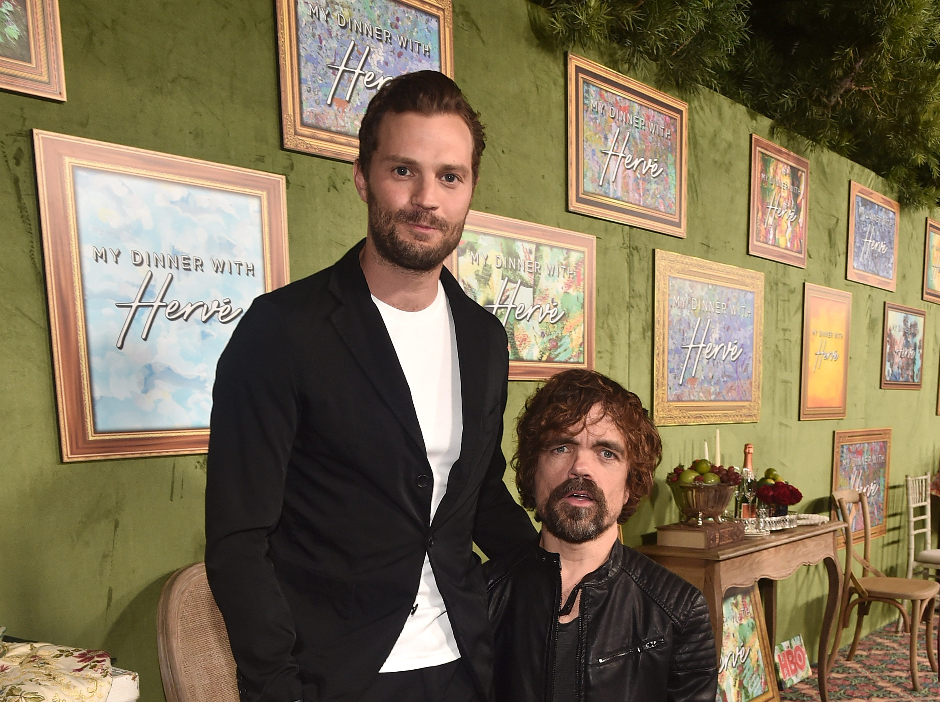 "Jamie Dornan (left) and Peter Dinklage attend the premiere of HBO Films' ""My Dinner With Herve"" at Paramount Studios on October 4, 2018 in Hollywood, California."