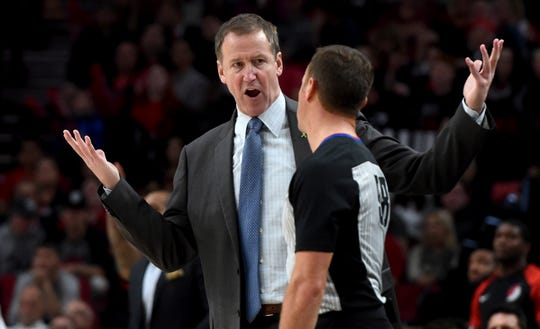 Trail Blazers coach Terry Stotts has words with referee Josh Tiven during a preseason game on Sunday.