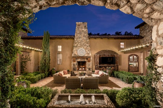 The mansion purchased by Sherman Ross Crowder, and his wife Greta Gissy, has four distinct entertaining spaces including two covered patio areas and a private spa patio.