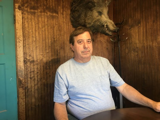 "Frontier Town owner Marc Peagler in the 1930s building that serves as office. ""Grandpa Herman killed that on the property here in either late '69 or early '70,"" he says of the javelina head."