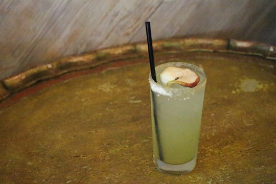 Bar Pesce's Adam's Apple ($10) has reposado tequila, lemon, apple syrup, muddled jalapeño, apple bitters and soda water.