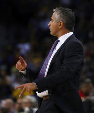 Suns coach Igor Kokoskov directs his team during a preseason game against the Warriors on Oct. 8.