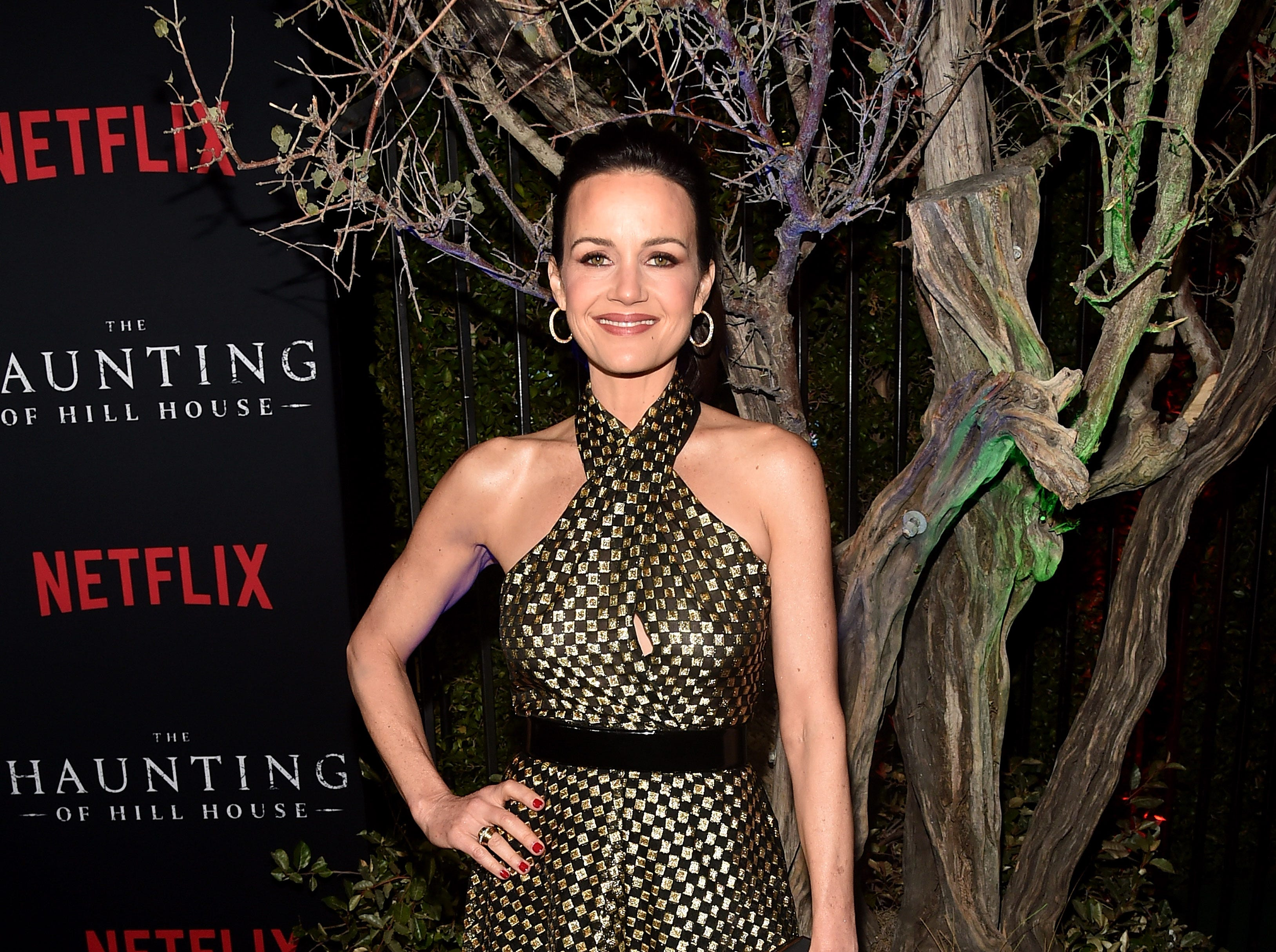"Carla Gugino attends the premiere of Neflix's ""The Haunting Of Hill House"" at ArcLight Hollywood on October 8, 2018 in Hollywood, California."