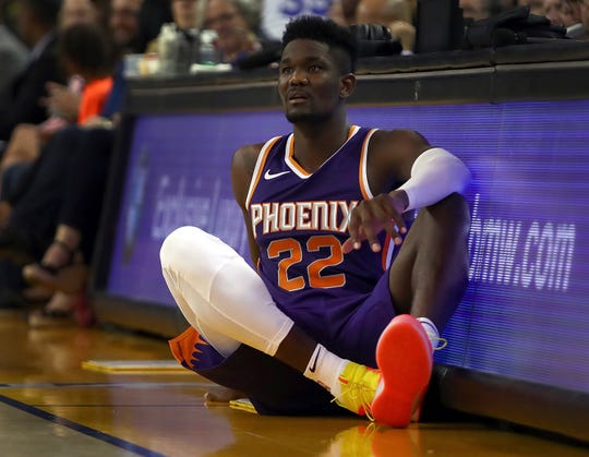 Phoenix Suns' Deandre Ayton waits on the sideline during the second half of a preseason NBA basketball game against the Golden State Warriors Monday, Oct. 8, 2018, in Oakland, Calif. (AP Photo/Ben Margot)