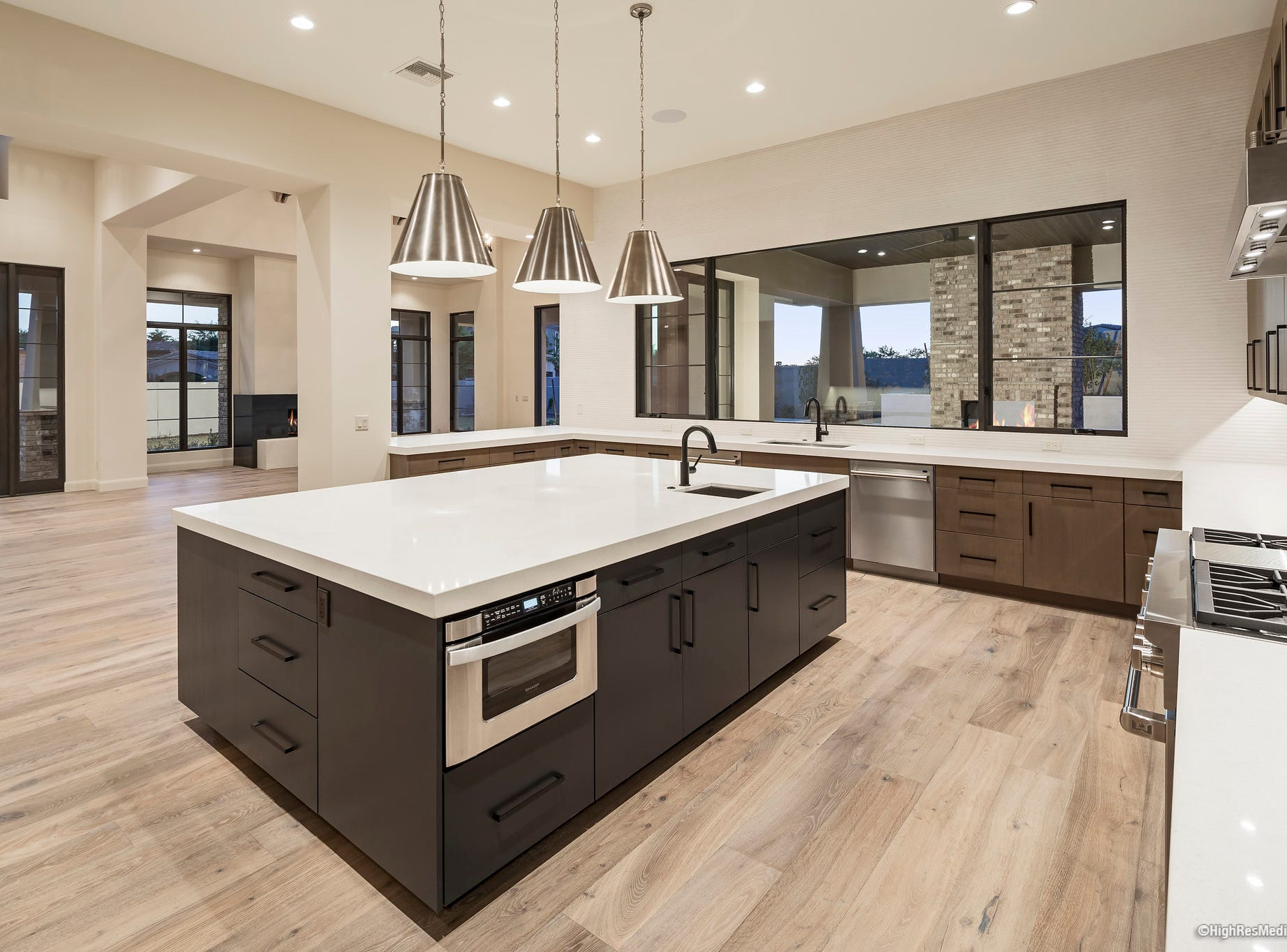 The house, purchased by Marc A. Lilley and Lisa M. Lilley, has an upgraded kitchen that includes white oak cabinetry, Wolf range, Subzero fridge, Asko duel dishwashers, and quartz counters.