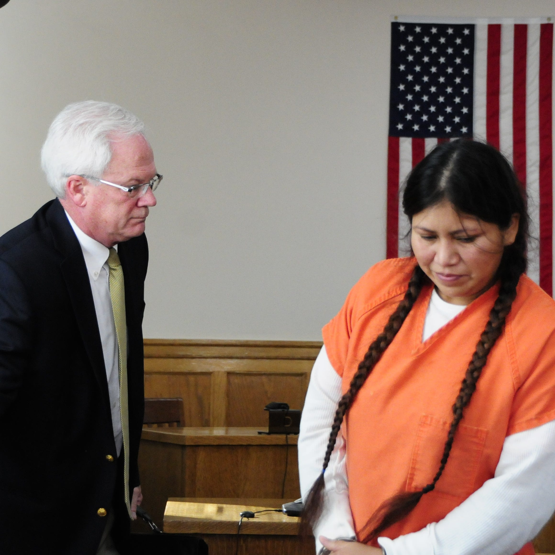 Francisca Vargas-Castillo passes her lawyer, Walter Salens, as she returns to her seat during a hearing in Sanilac District Court.