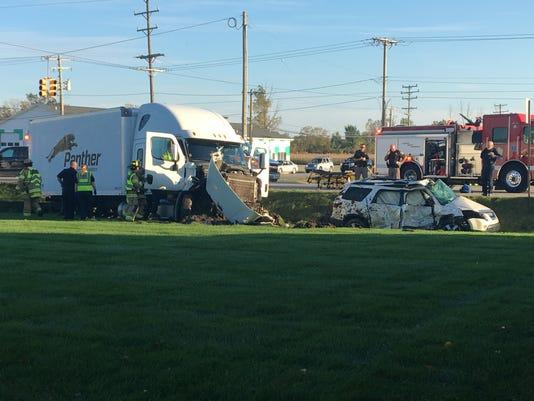 Crash closes Dove Road at Michigan Road