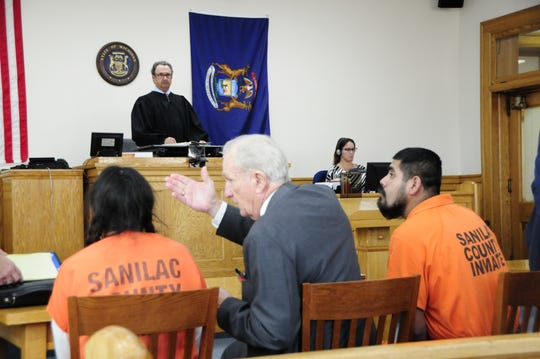 Interpreter Victor Moigis explains District Judge Gregory Ross' instructions to Francisca Vargas-Castillo during a court hearing on Tuesday, Oct. 9, 2018. Her brother, Leobardo Torres-Castillo, looks on.