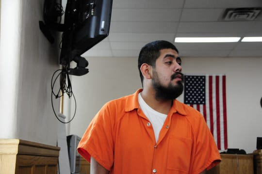 Leobardo Torres-Castillo returns to his seat during a hearing in Sanilac District Court on Tuesday, Oct. 9, 2018.