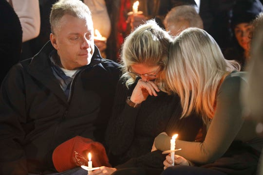 Family members console one another at the Mohawk Valley Gateway Overlook Bridge in the City of Amsterdam on Oct. 8, 2018, during a candlelight vigil for the 20 people who were killed in a limousine accident in Schoharie.