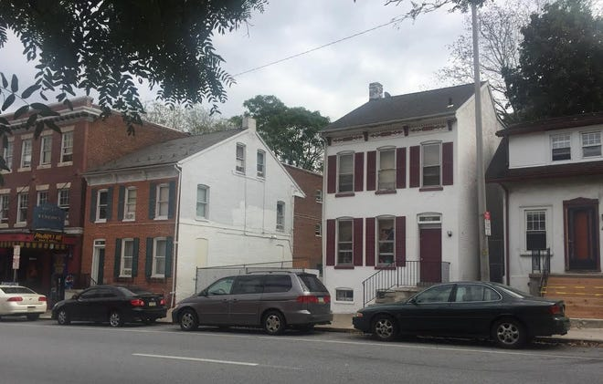 The owner of the Lincoln Hotel and Pandora's Box Bar and Grill is seeking to change the variance to allow her to run a boarding house a few buildings down, at 454 E. Market St.