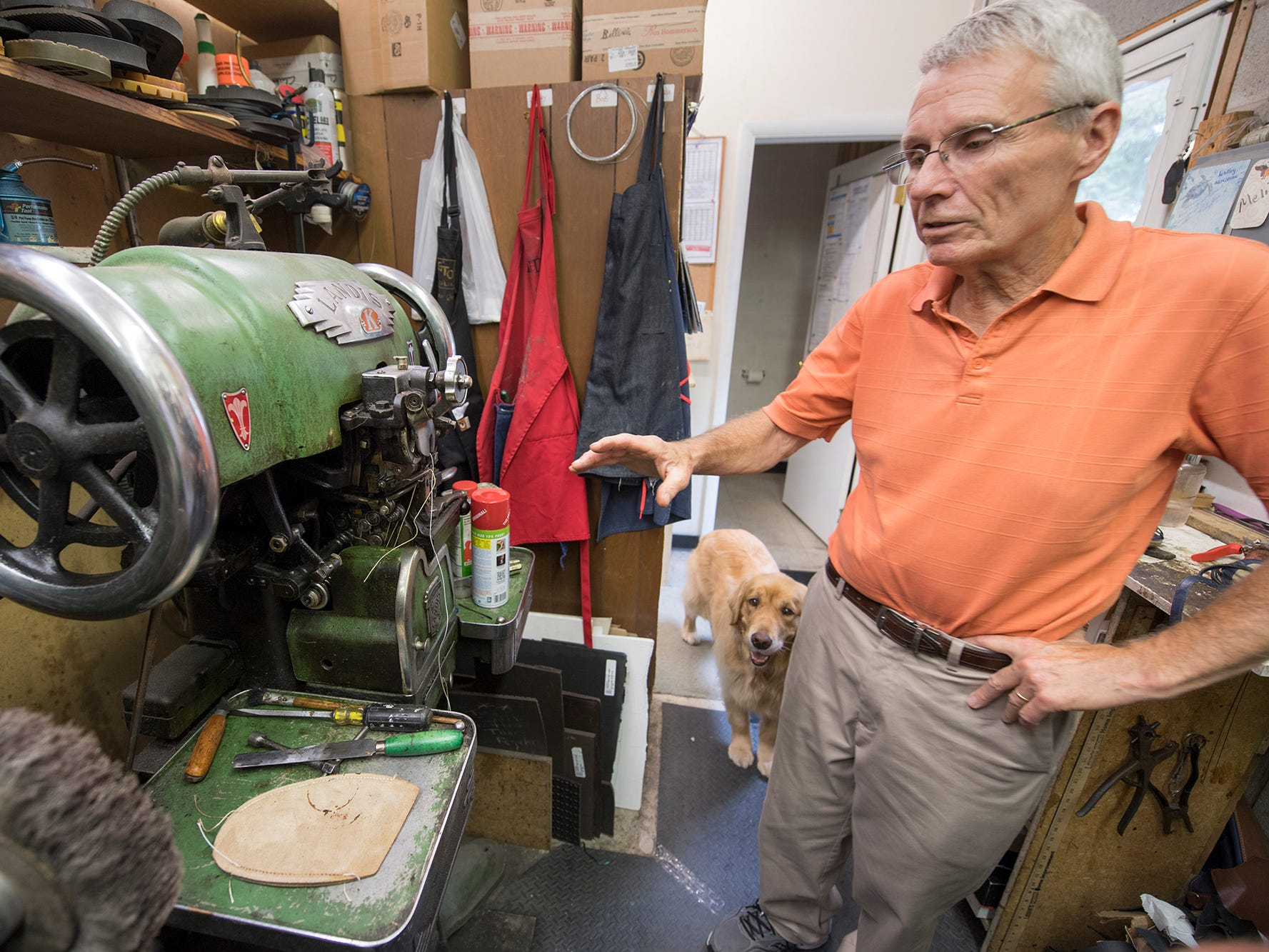 Great-grandson Bob Reineberg stands with a stitcher that sews a sole from the outside, at Reineberg's Shoes & Shoe Repair in Springettsbury Township. The business is closing soon, after 141 years since beginning in downtown York.