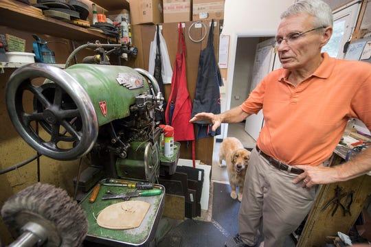 Great-grandson Bob Reineberg stands with a stitcher that sews a sole from the outside, at Reineberg's Shoes & Shoe Repair in Springettsbury Township, closing after 141 years since beginning in downtown York.