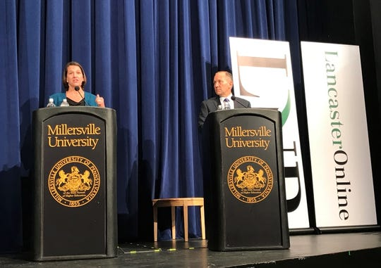 Democrat Jess King and GOP Congressman Lloyd Smucker debate at Millersville University October 8, 2018.