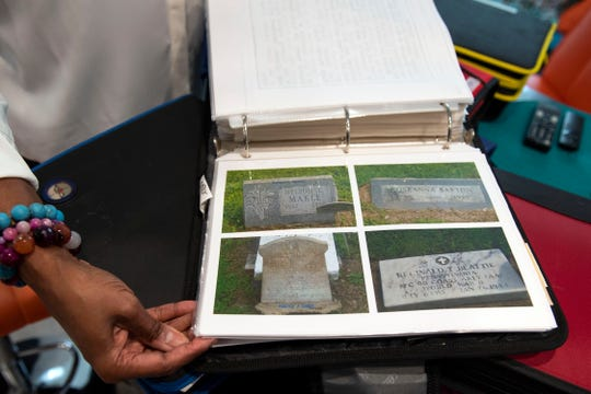 Photographs of gravestones fill some pages in one binder, helping Neicy DeSheilds-Moulton keep track of her deceased relatives, Monday, Oct. 8, 2018. Niece DeSheilds-Moulton has been researching her family roots for 21 years. One of her more recent findings was learning that her family shared DNA with one of the founding families of Maryland, the Ridgley family.