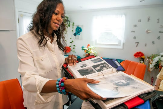 Neicy DeSheilds-Moulton flips through one of many binders she has packed with family history over the past 21 years, Monday, Oct. 8, 2018. One of her more recent findings was learning that her family shared DNA with one of the founding families of Maryland, the Ridgley family.