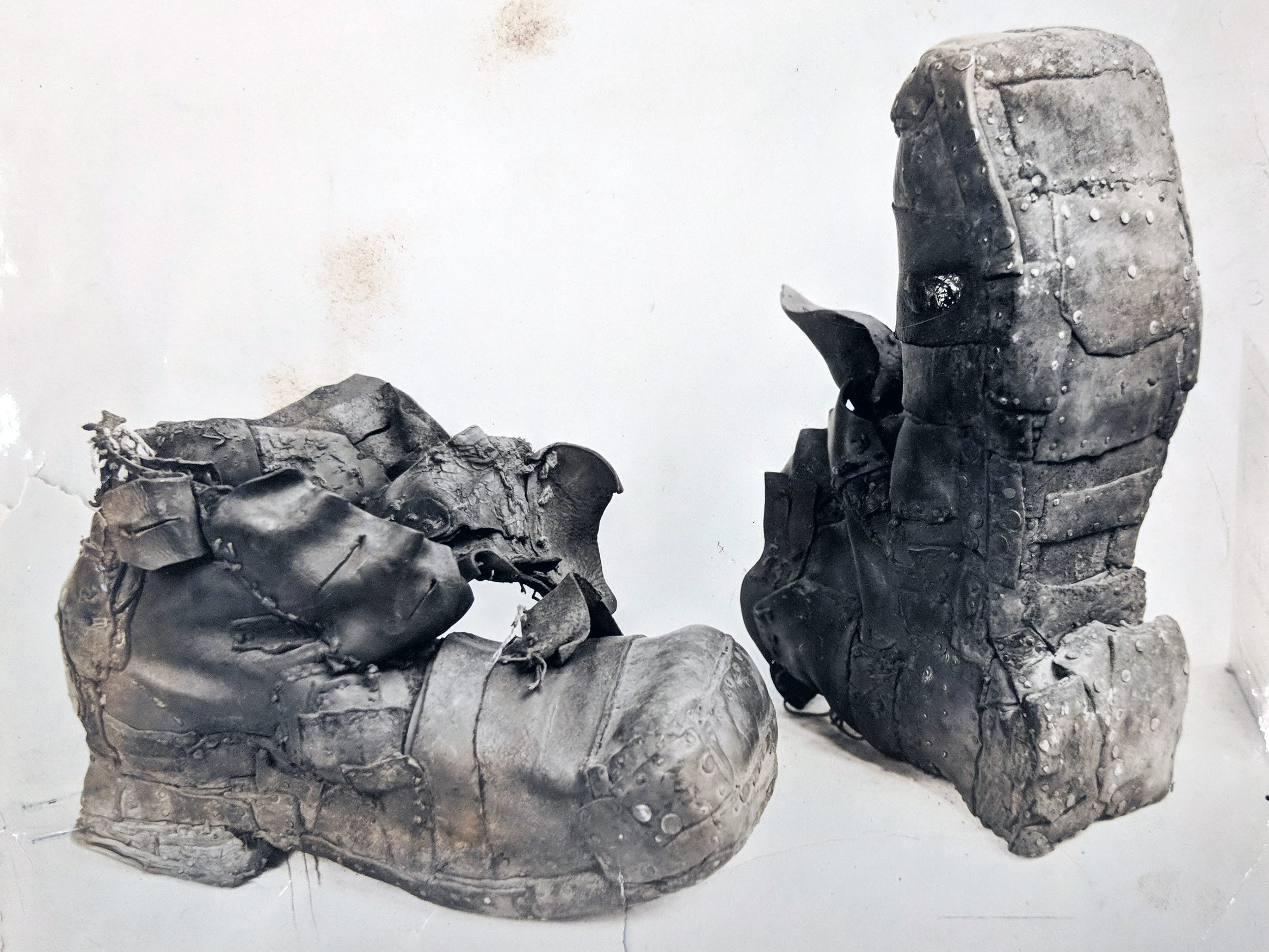 This pair of shoes once belonged to Edward Molenaux, who purchased them in 1905 from Reineberg's shoe store in York. Molenaux resolved to never part with the shoes and kept attaching found pieces of  leather to them until the shoes were 14 1/2 inches long and weighed about nine pounds each. Reineberg's still has the pair of shoes.
