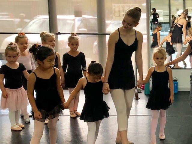 SNB trainee Annika Johnson, teaches little ones to bow.