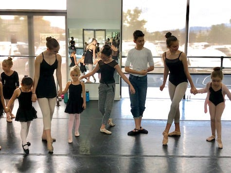 SNB trainees Annika Johnson and Dafne D'Olimpio assist little pages as they greet Clara (Haley Pershall) and the Nutcracker Prince (Jacob Sheridan).