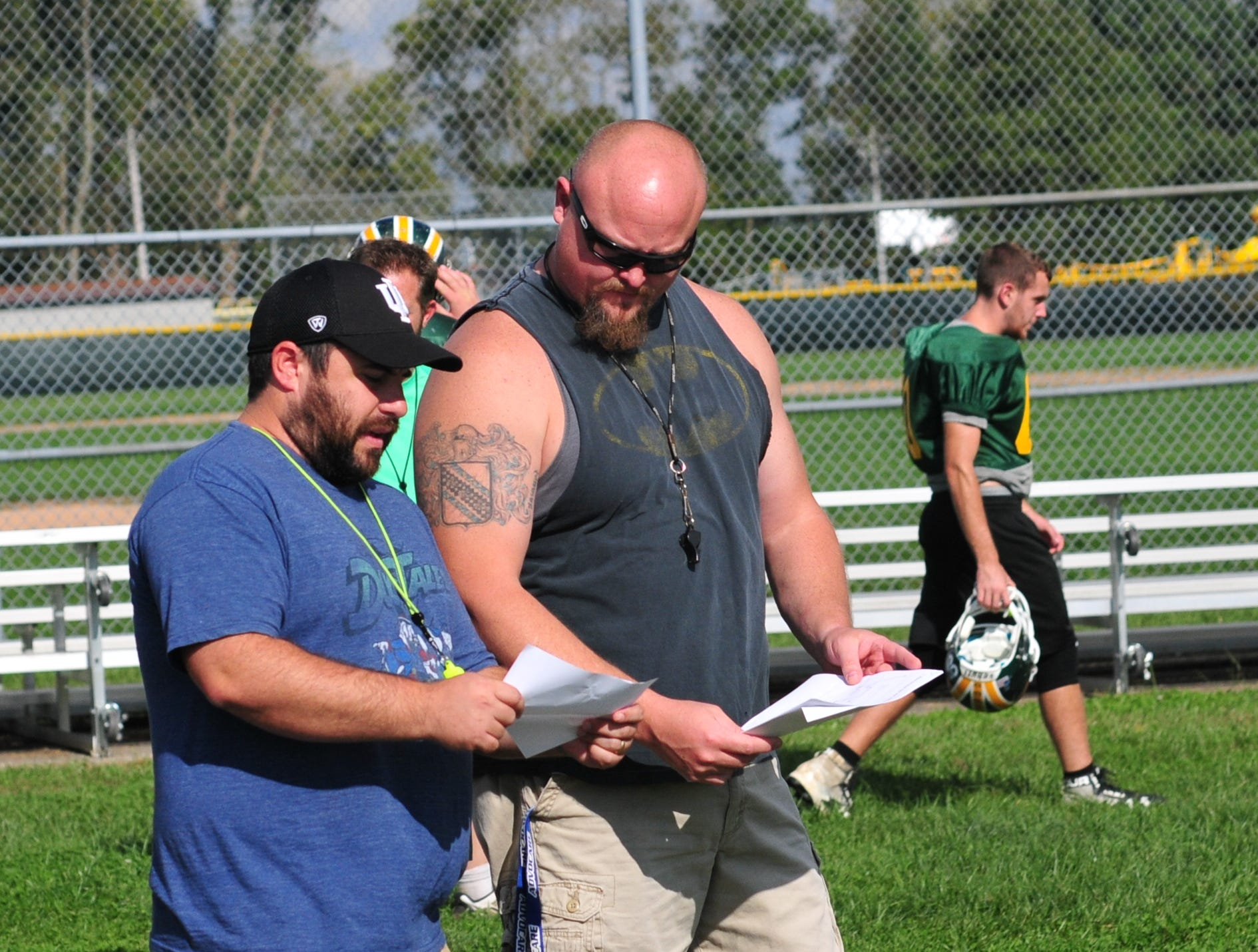Wes Oler, left, talks with assistant coach Jamie Mastriano. Oler was named Northeastern High School's football co-coach after longtime head coach Mike Roeder resigned on Oct. 3, 2018.