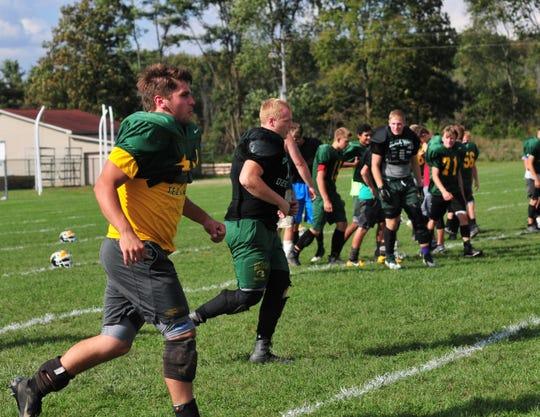 Northeastern High School football players practice Tuesday, Oct. 9, 2018.
