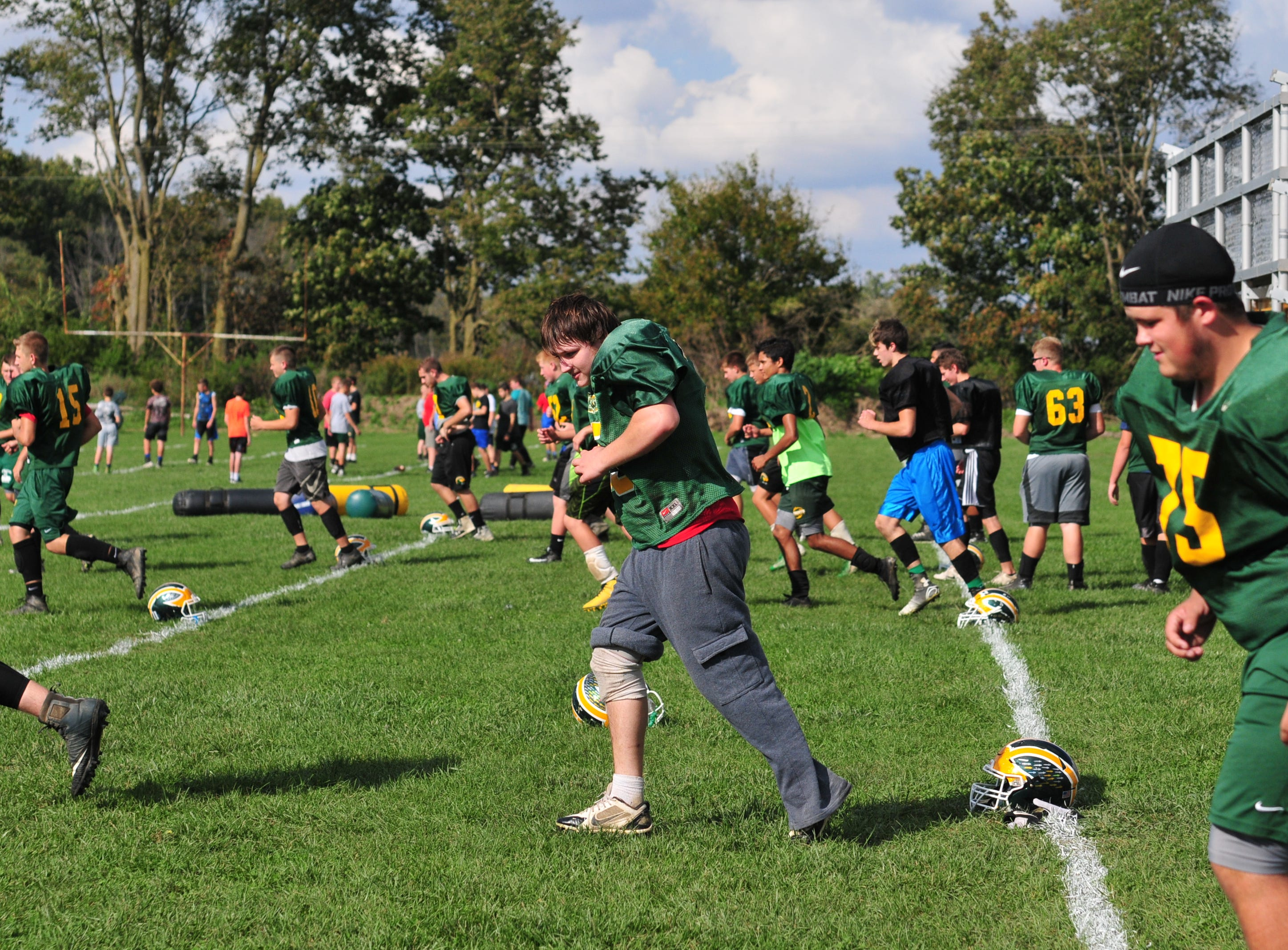 Northeastern High School football players practice Tuesday, Oct. 9, 2018.