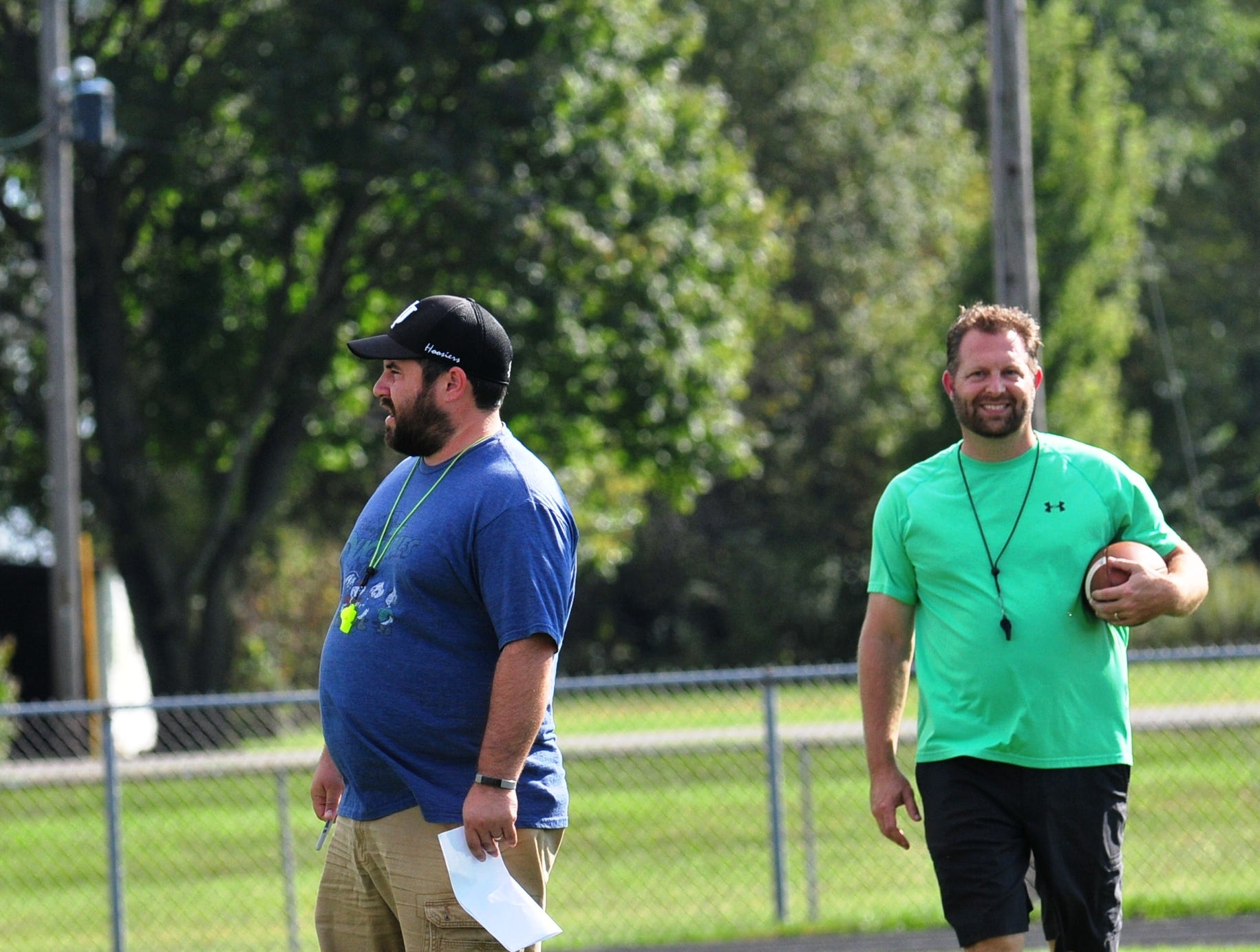 Wes Oler, left, and Ryan Halloran were named Northeastern High School's football co-coaches after longtime head coach Mike Roeder resigned on Oct. 3, 2018.