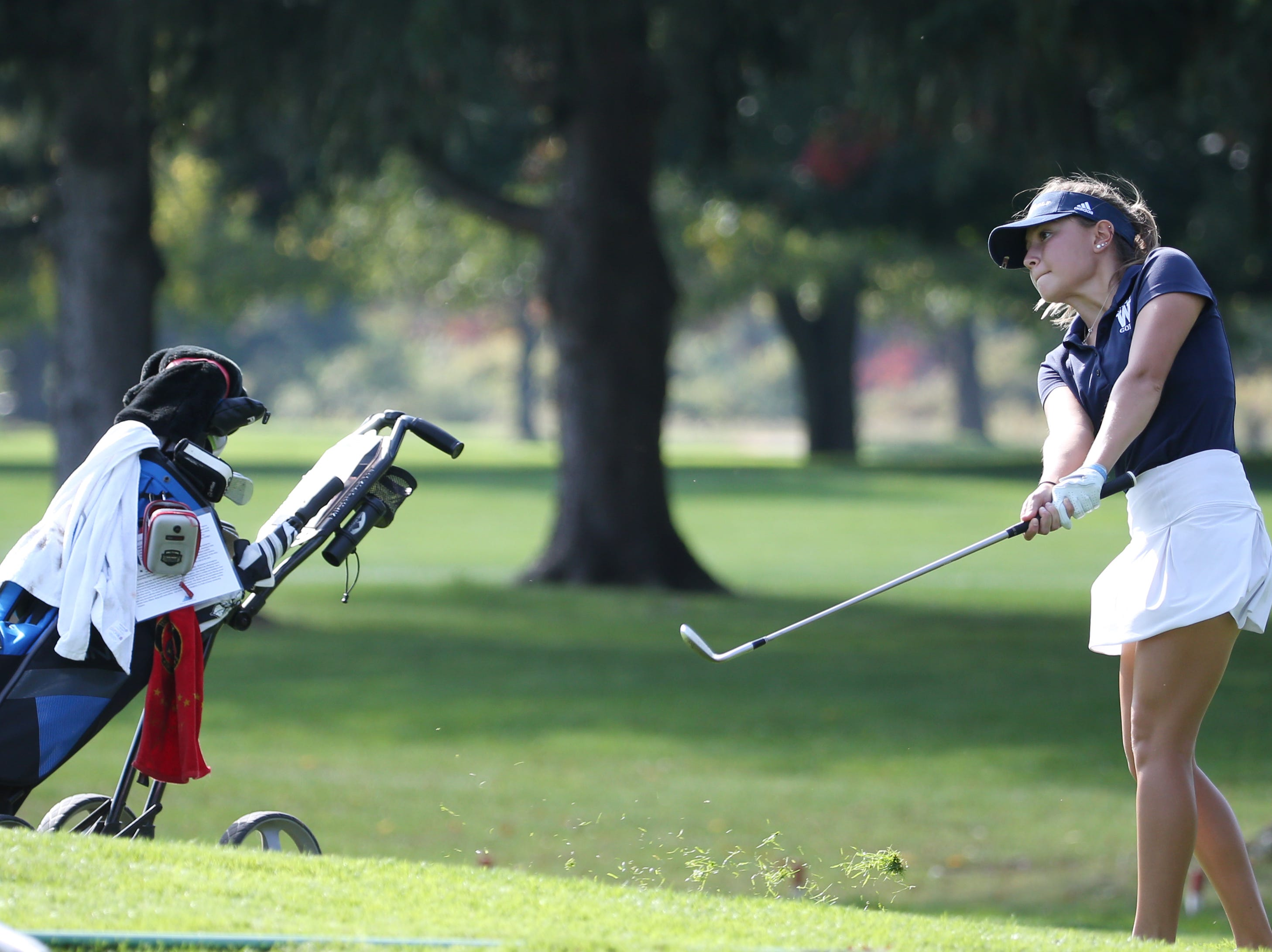 Mikah McDonnell chips to 9 at the Section V girls golf championship at Deerfield Country Club.
