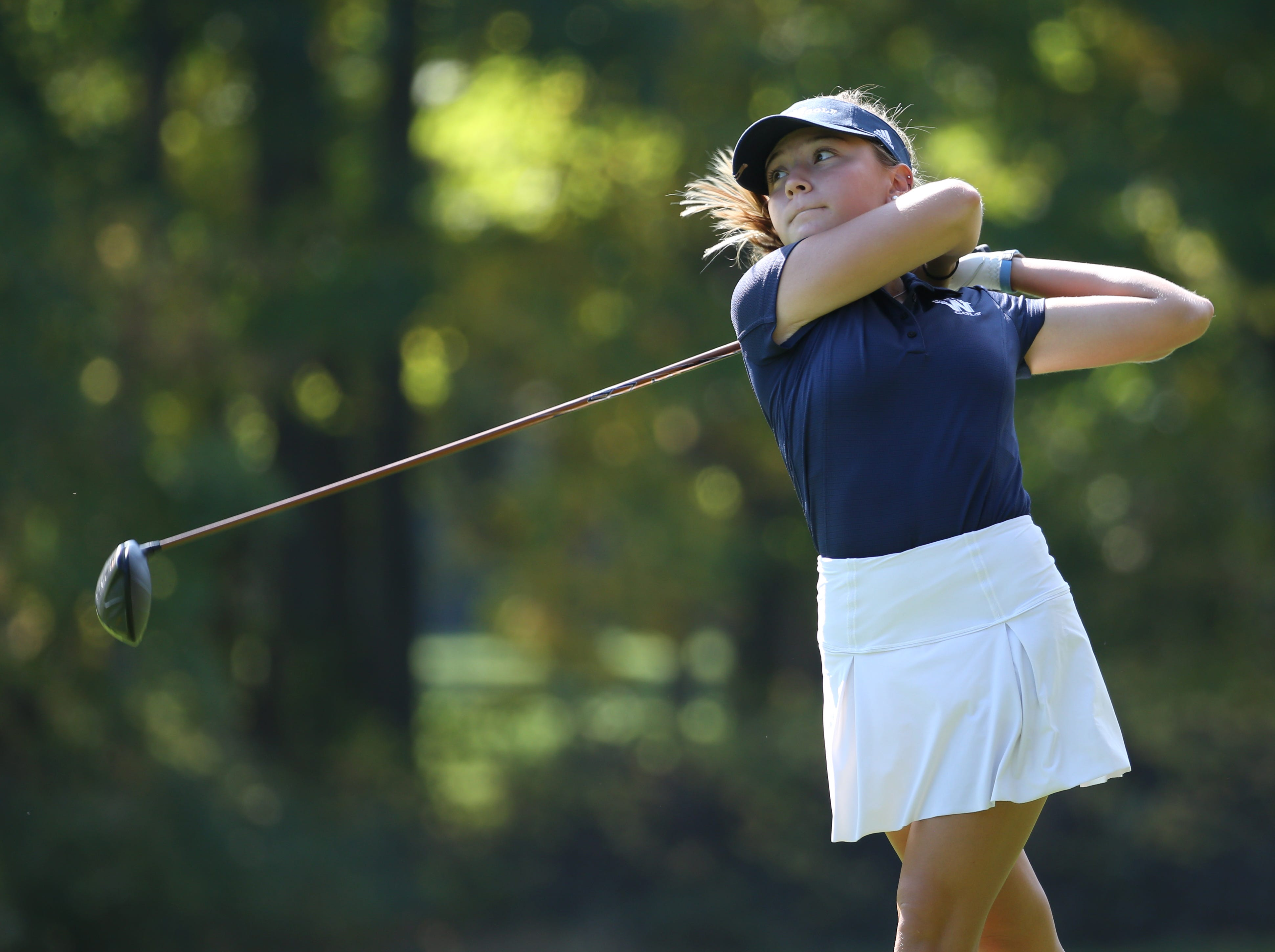 Mikah McDonnell tees off at the sixth hole at the Section V girls golf championship at Deerfield Country Club.