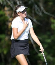 Claire Yioulos reacts to a putt she made to save par on the eighth hole at the Section V girls golf championship at Deerfield Country Club.