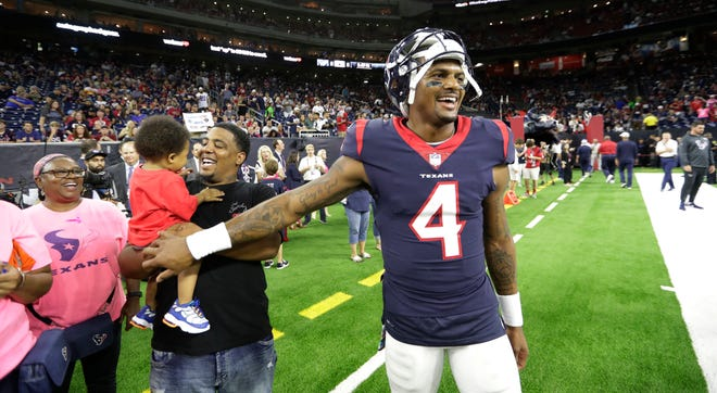 """Houston Texans quarterback Deshaun Watson (4) is loving life. The second-year NFL pro had 415 yards of total offense in Sunday's 19-16 overtime win over Dallas in the """"Battle of Texas'' game."""
