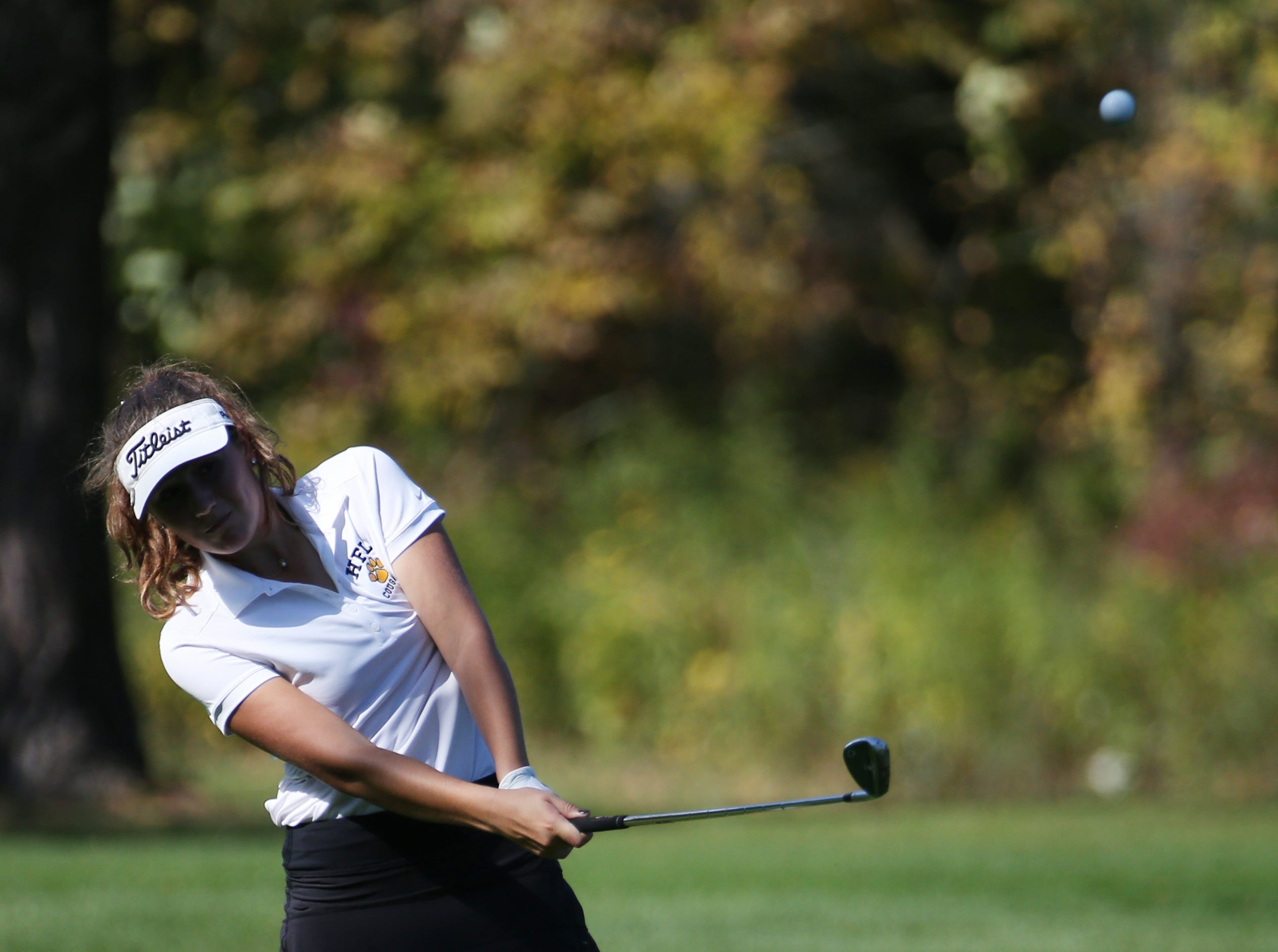 Claire Yioulos chips onto 6 at the Section V girls golf championship at the Deerfield Country Club.