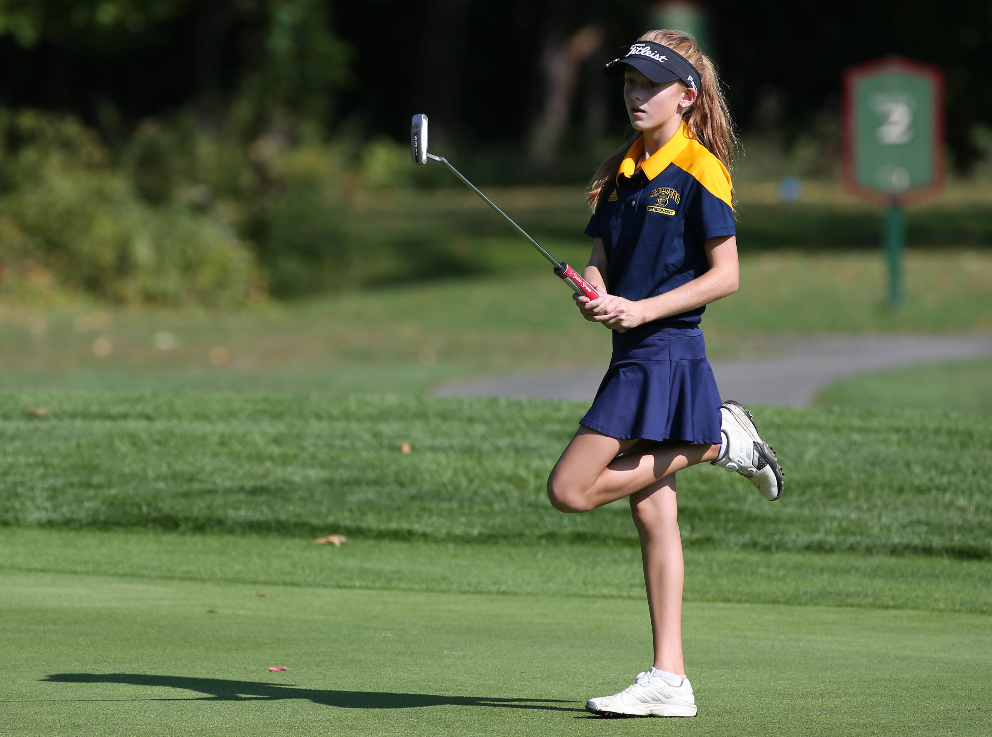 Julia Zigrossi reacts to a missed putt on 1 at Section V girls golf championship at Deerfield Country Club.
