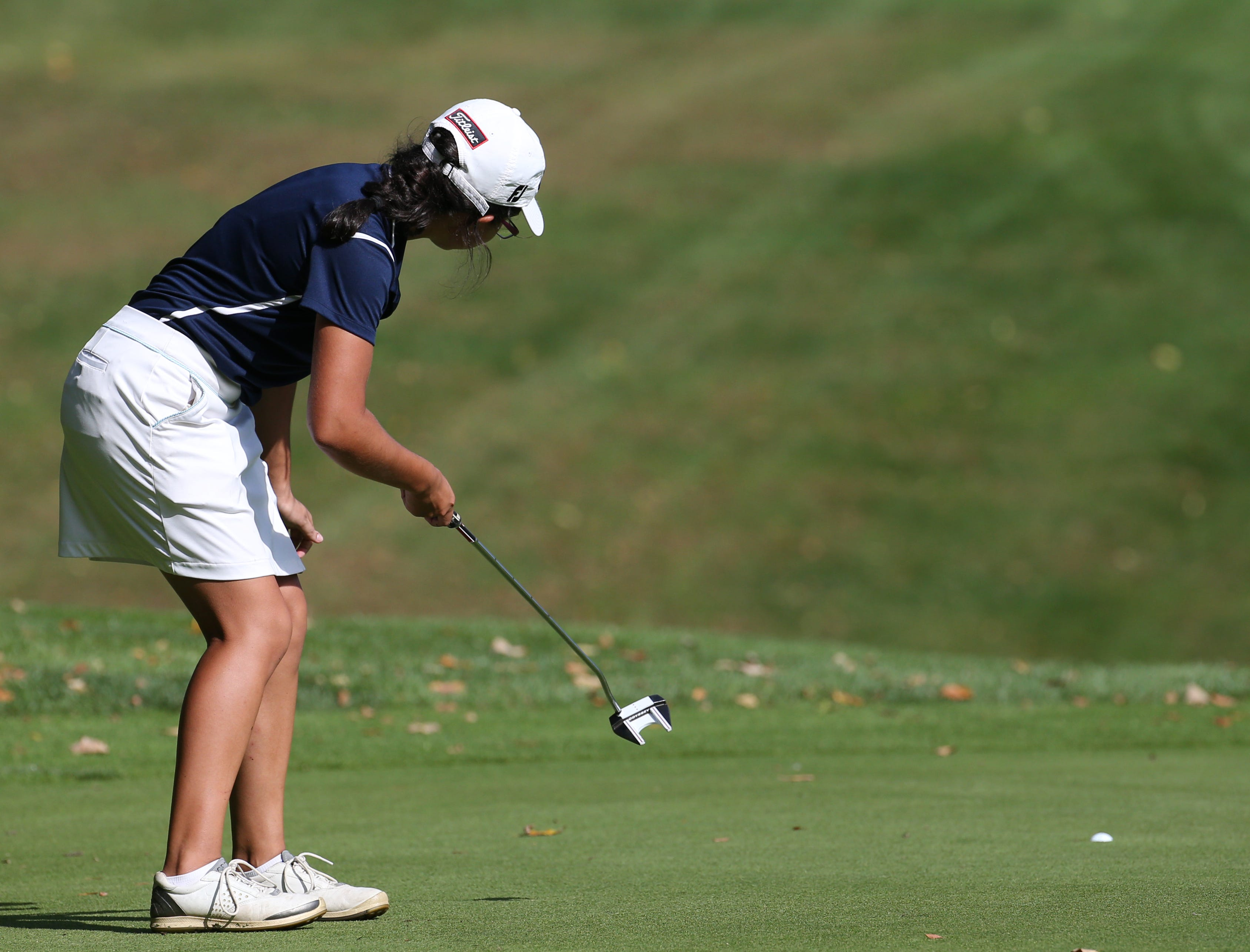 Athena Baronos reacts to making this putt on the eighth hole for birdie at Section V girls golf championship at Deerfield Country Club.