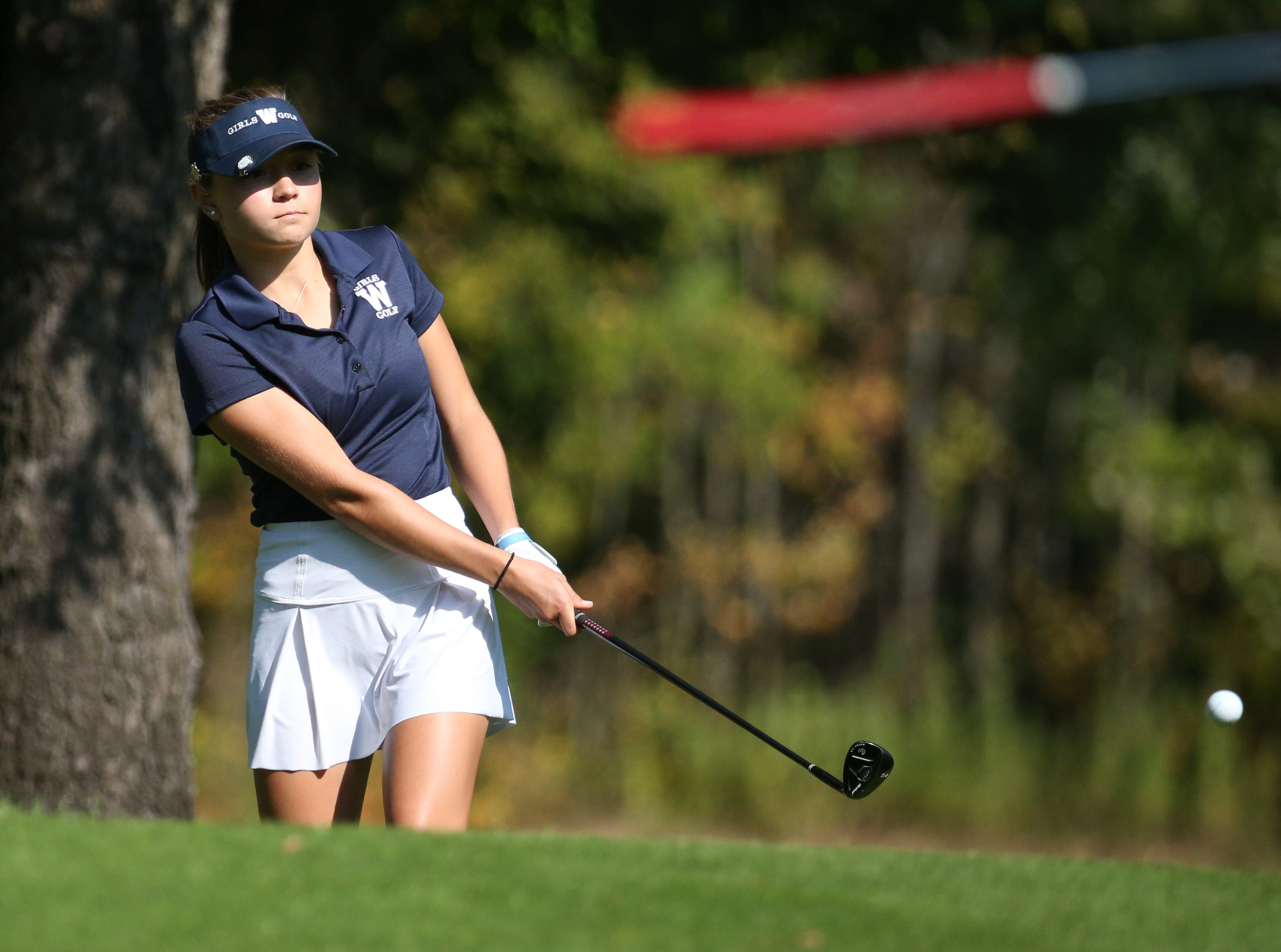Mikah McDonnell chips on to 2 at the Section V girls golf championship at Deerfield Country Club.