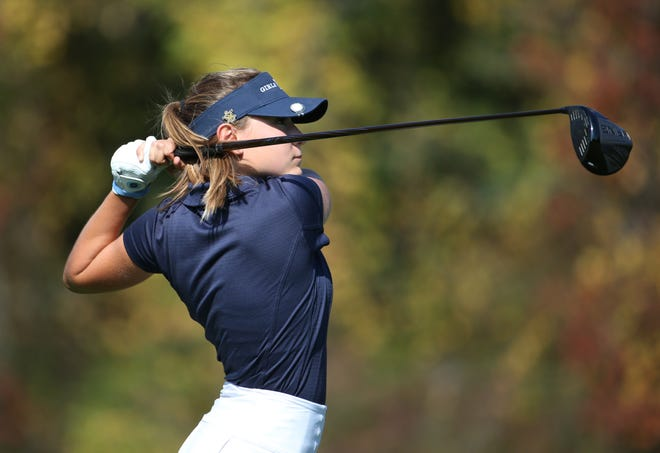 Mikah McDonnell tees off at the fifth hole at the Section V girls golf championship at Deerfield Country Club.
