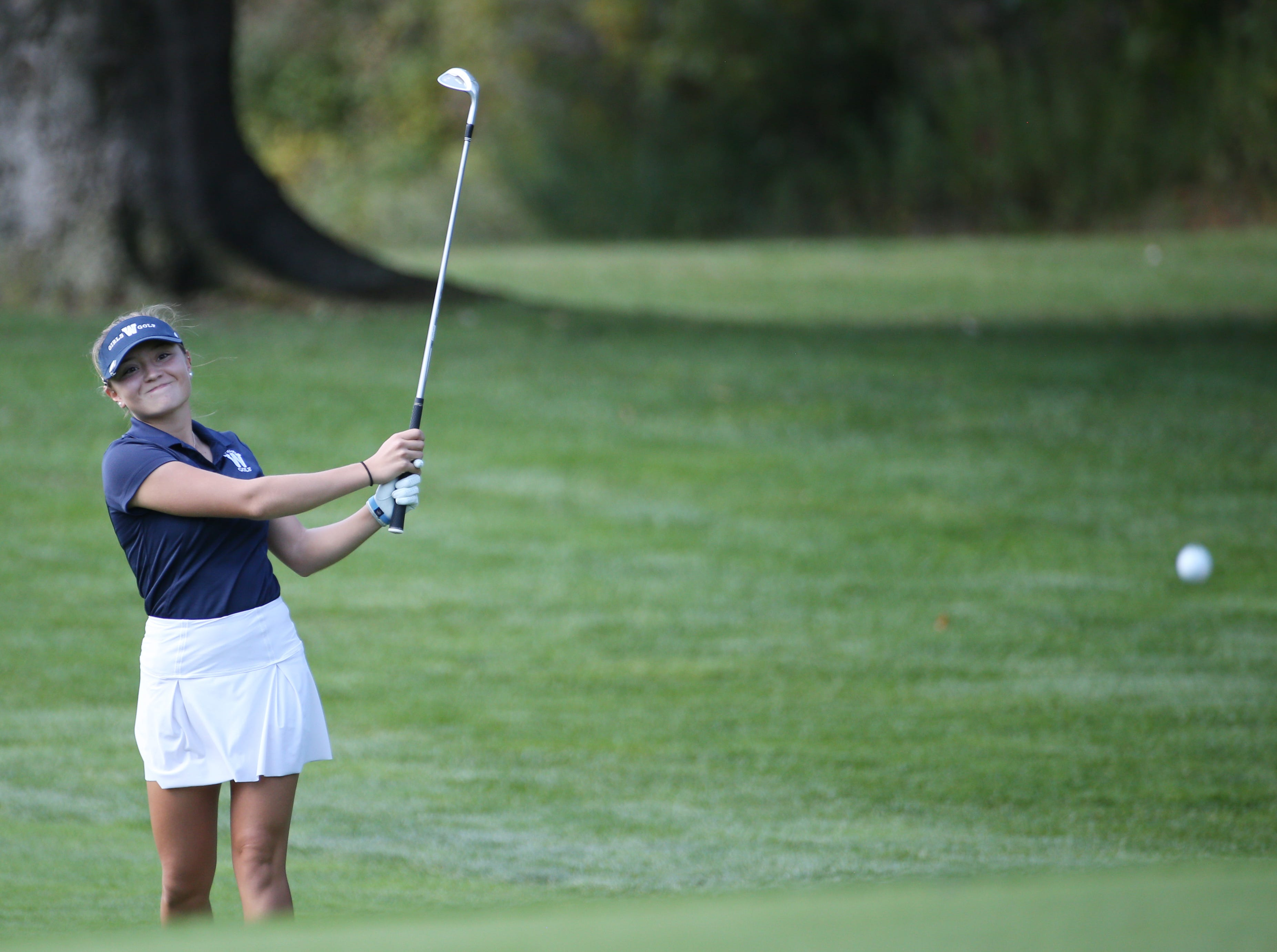 Mikah McDonnell chips onto 5 at the Section V girls golf championship at Deerfield Country Club.