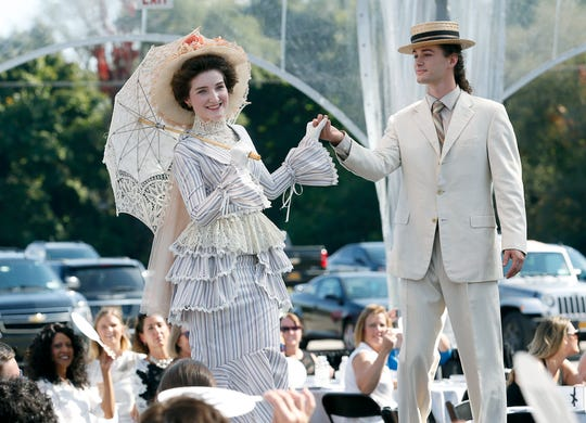 Showcasing period clothing from the 1890s during the Fashion Week 2018 kickoff on E. Highland Drive, next to Midtown Athletic Club.