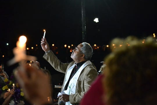 A candlelight vigil honoring the 20 victims in Saturday's limousine crash in Schoharie drew thousands to Amsterdam's  Mohawk Valley Gateway Overlook Pedestrian Bridge Monday night.