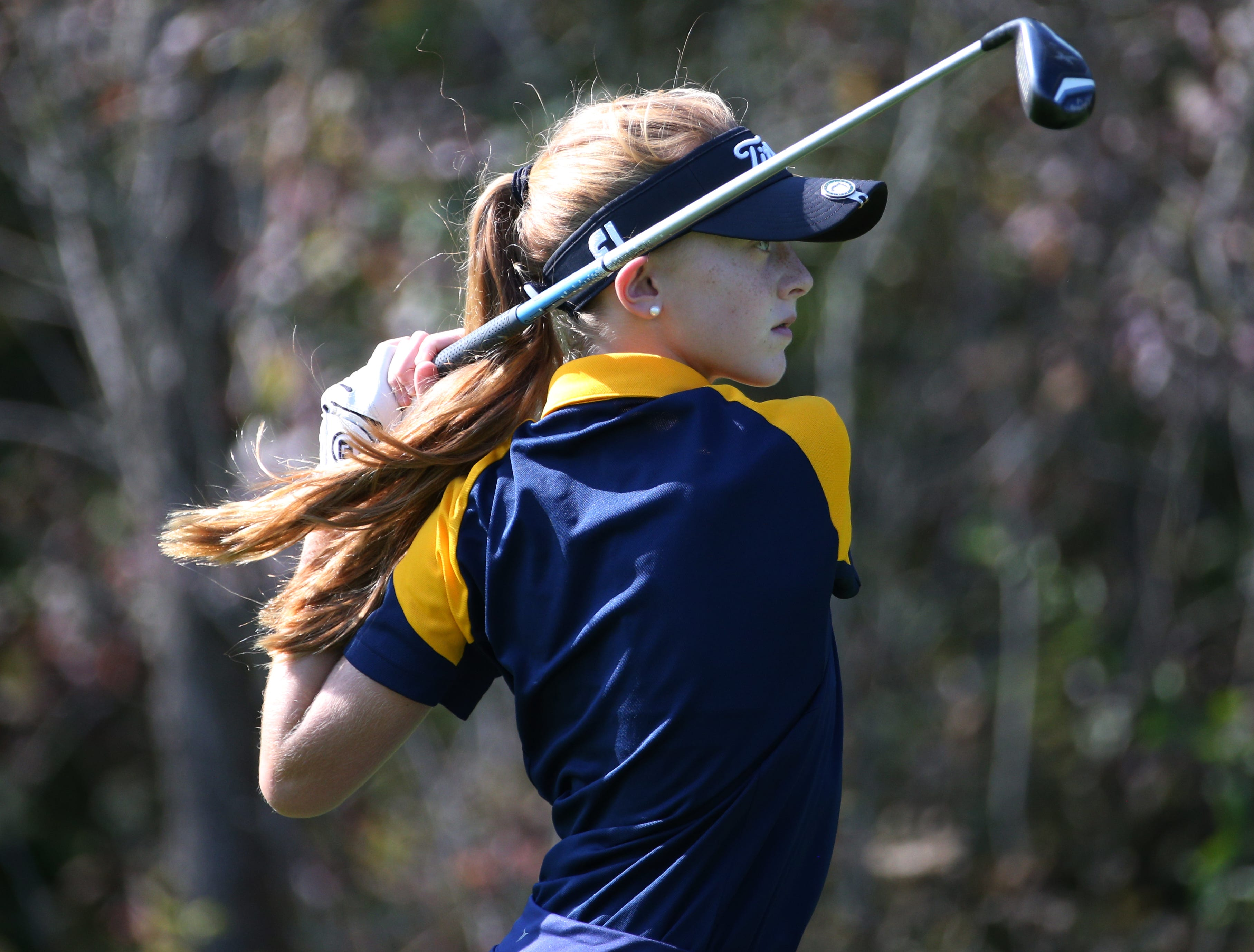 Julia Zigrossi tees off at the fourth hole at the Section V girls golf championship at Deerfield Country Club.