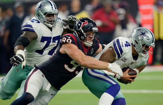 Houston Texans defensive end J.J. Watt (99) sacks Dallas Cowboys quarterback Dak Prescott (4) during the second half of an NFL football game, Sunday, Oct. 7, 2018, in Houston. Watt, coming off broken knee surgery, has six sacks to tie for NFL lead.